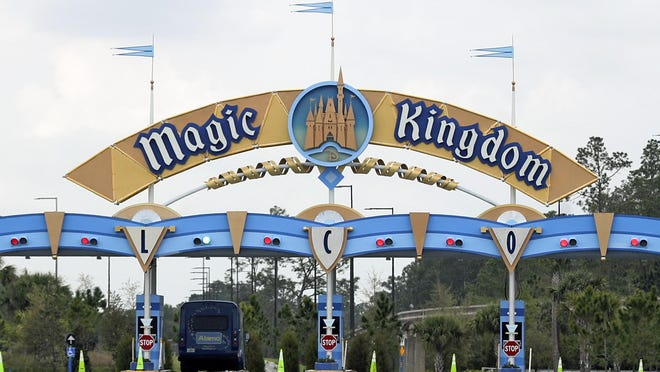 FILE - In this March 16, 2020, file photo, the entrance to the parking lot at the Magic Kingdom at Walt Disney World is closed in Lake Buena Vista, Fla. Squeezed by limits on attendance at its theme parks and other restrictions due to the pandemic, The Walt Disney Co. said Tuesday, Sept. 29, 2020, it planned to lay off 28,000 workers in its parks division in California and Florida.