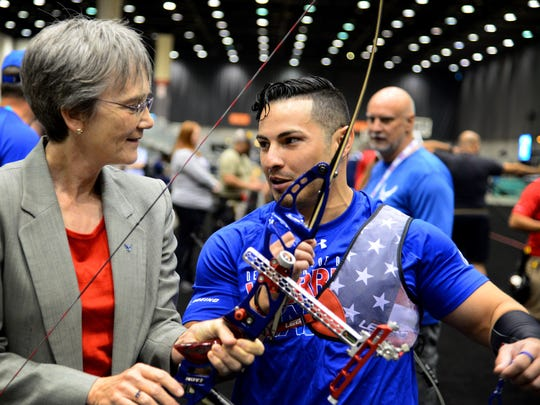 Secretary of the Air Force Heather Wilson speaks with Staff Sgt. Vincent Cavazos, a security forces troop from Fresno, Calif., during a meet-and-greet with archery team athletes at the 2017 Warrior Games July 1, 2017 at McCormick Place-Lakeside Center in Chicago. Cavazos provided Wilson with details surrounding the sporting event as well as bow handling techniques.
