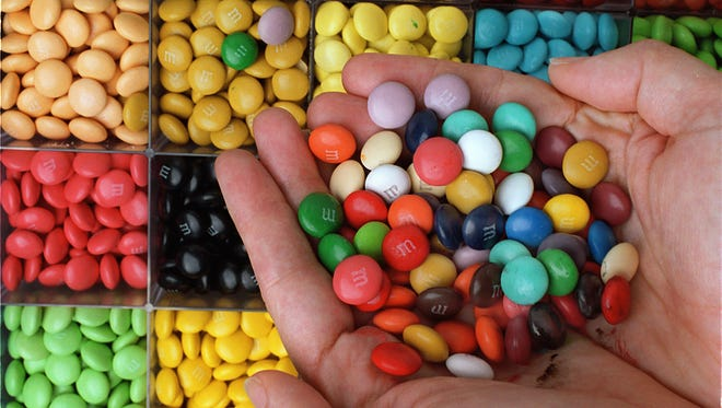 The makers of M&M's, Mars Chocolate North America, committed to reducing sugar and calories in products over the next five years.