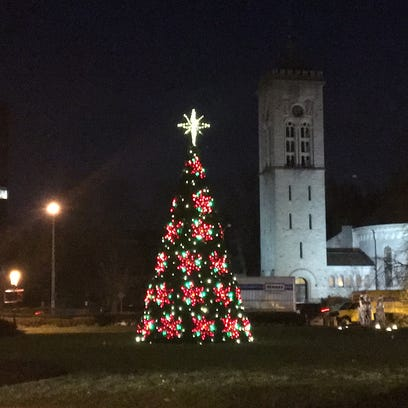 The 26-foot-tall artificial Christmas tree shows its