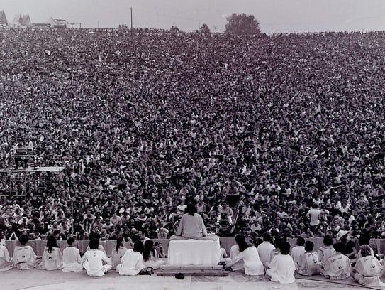 Swami Satchidananda gave the opening Woodstock speech