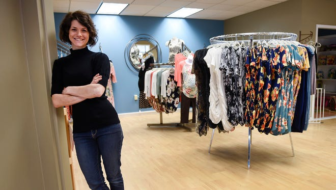 Paula Roufs, owner of For All of Maternity, shown Wednesday, May 9, at the new store located in Centennial Plaza.