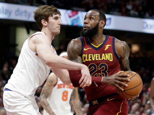 Cleveland Cavaliers' LeBron James, right, drivers past New York Knicks' Luke Kornet, from Switzerland, in the first half of an NBA basketball game, Wednesday, April 11, 2018, in Cleveland. (AP Photo/Tony Dejak)