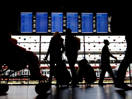 Travelers walk to their gates at O'Hare International Airport in Chicago.