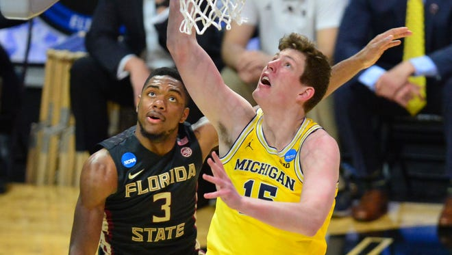 Jon Teske, shown here against Florida State, said the special message the Wolverines received from the 1989 championship team 'it's cool to see those guys care about us.'