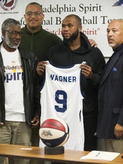 Dajuan Wagner signs a contract to play for the ABA Philadelphia Spirit during a press conference in Burlington on Nov. 6. (L-R) Jeffrey Rice of Whole Armour apparel, Gordy Bryan, vice president of basketball operations, Dajuan Wagner, Troy Oglesby, CEO of ASA Philadelphia Spirit.