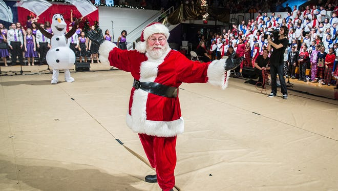 Hundreds attend the annual Christmas Sing at the Muncie Fieldhouse Sunday.