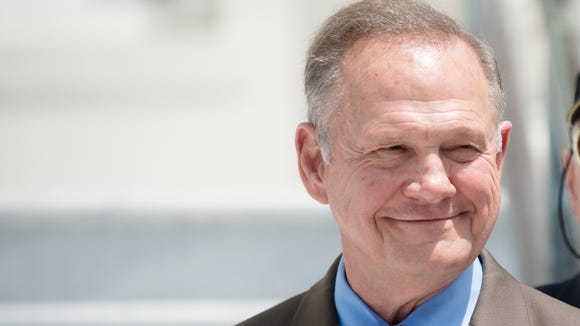 Roy Moore smiles before announcing his Alabama Junior Senate race candidacy on April 26, 2017, in Montgomery, Ala. Moore, who was the suspended Chief Justice of the Alabama Supreme Court, said he filed paperwork to resign that position.