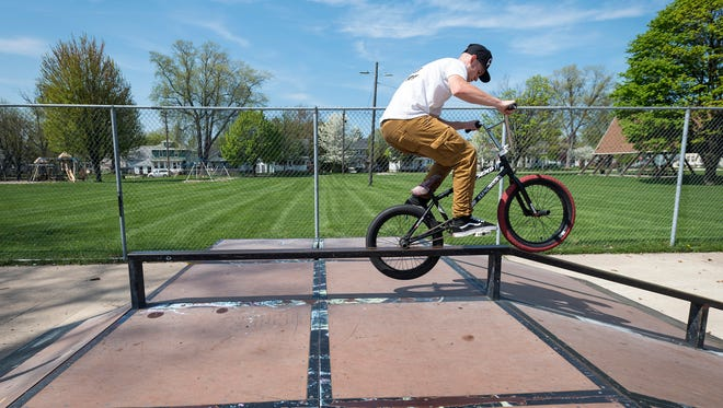 Dougie Rutherford does tricks on his BMX bike at the Optimist Park skate park Wednesday, May 18. Rutherford said he sees more BMX bikers at Optimist Park than skateboarders, who usually stick to Pine Grove Park.