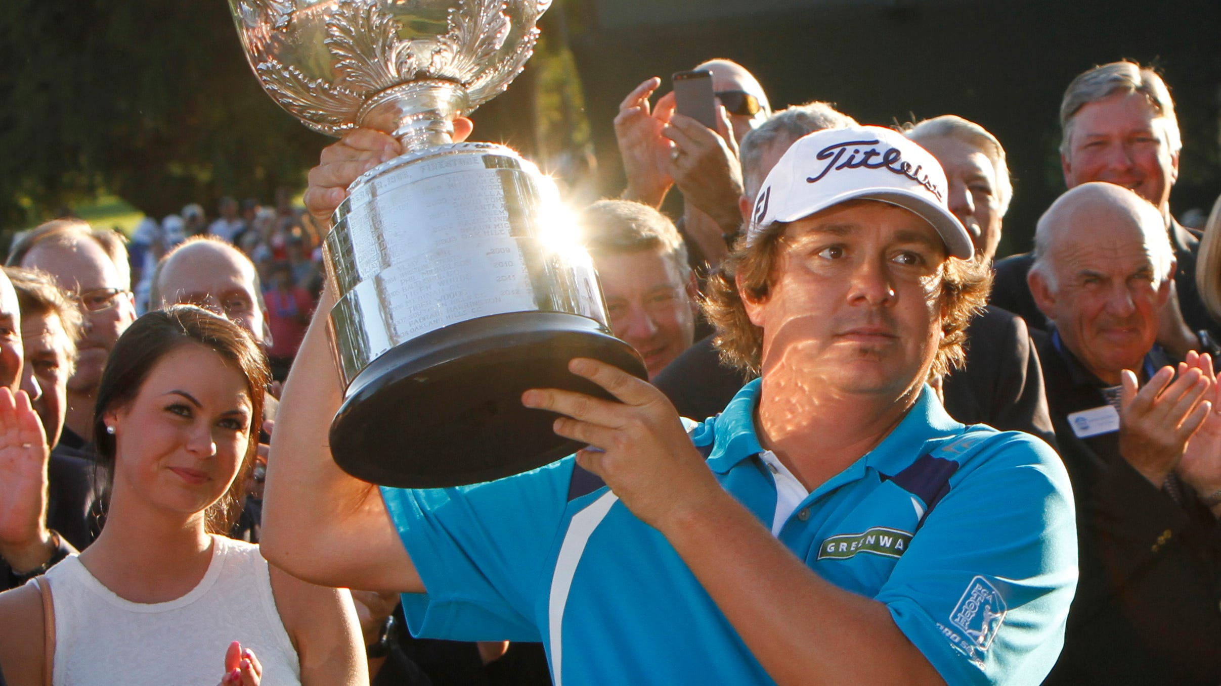 Jason Dufner raises the Wanamaker Trophy as wife Amanda looks on following his two stroke victory at the final round of the 95th PGA Championship Sunday, Aug. 11, 2013 at Oak Hill Country Club in Pittsford.