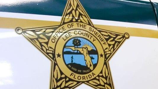 Lee County Sheriff's Office logo on a deputy cruiser.