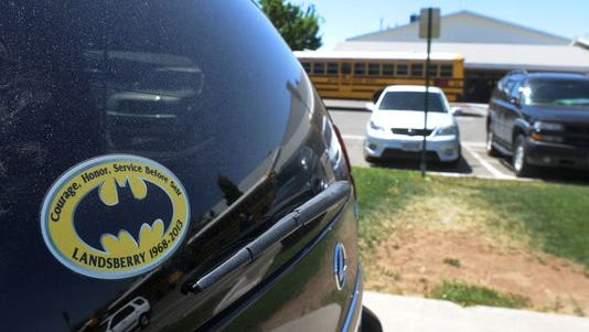 An SUV with a sticker dedicated to slain teacher Michael Landsberry was parked in front of Sparks Middle School on Tuesday.