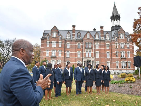 Dr. Paul T Kwami, Musical Director of the Fisk Jubilee Singers, listens as the Fisk Jubilee Singers sing a song as they were honored with a historic marker on the  Fisk University campus. The marker commemorates the Singers and their departure from campus in 1871 to tour the United States and abroad to raise funds for Fisk University.