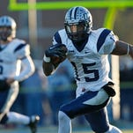 New Hampshire wide receiver R.J. Harris (15) runs after a reception during the first half of an NCAA football playoff game, Saturday, Dec. 7, 2013, in Orono, Maine. (AP Photo/Robert F. Bukaty)