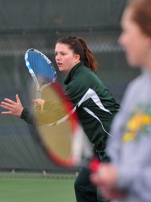 CMR's Ally Dube receives a serve during her doubles match at the crosstown tennis match against Great Falls High on Tuesday.