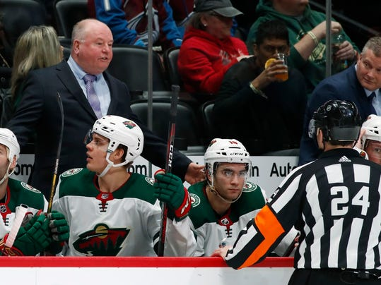 Minnesota Wild head coach Bruce Boudreau argues a call with referee Graham Skiliter in the second period of an NHL hockey game against the Colorado Avalanche Friday, March 2, 2018, in Denver. (AP Photo/David Zalubowski)