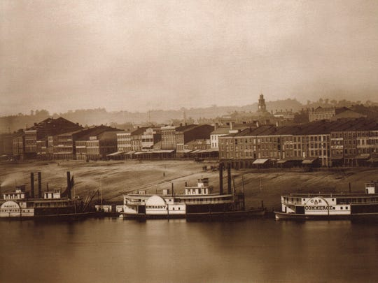 Plate No. 2 - Daguerreotype of the Cincinnati skyline taken on September 24, 1848 by photographers Charles Fontayne and William Porter from a hill in Newport, Ky., at the present-day site of the Newport Aquarium. This shows almost the entire public wharf to Ludlow Avenue. The prominent church clock tower belongs to the Second Presbyterian Church between Vine and Race.  Cassilly's Row occupies the right foreground. Today, this would be near the site of Great American Ball Park and US Bank Arena. The steamboats visible are the General Worth, Embassy and Car of Commerce. From the Collection of The Public Library of Cincinnati and Hamilton County.