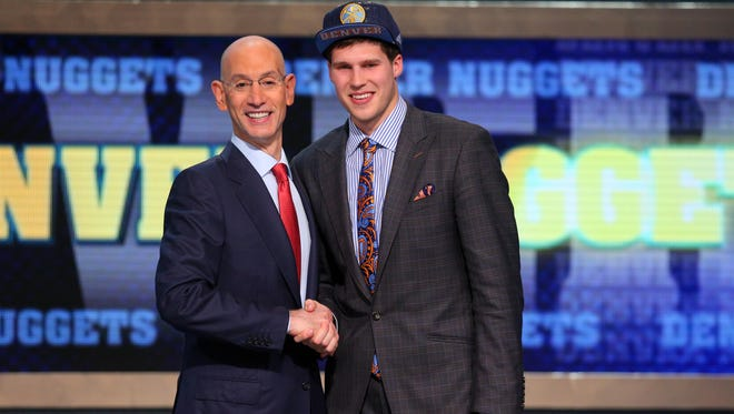 Doug McDermott (Creighton) shakes hands with NBA commissioner Adam Silver after being selected as 11th pick by Denver. He was traded to the Chicago Bulls.