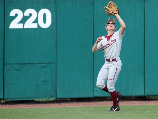 FSU's Morgan Klaevemann catches a ball in center field against Jacksonville State as the Seminoles win 8-0 in the opening game of their NCAA Regional Tournament at JoAnne Graf Field on Friday, May 18, 2018.