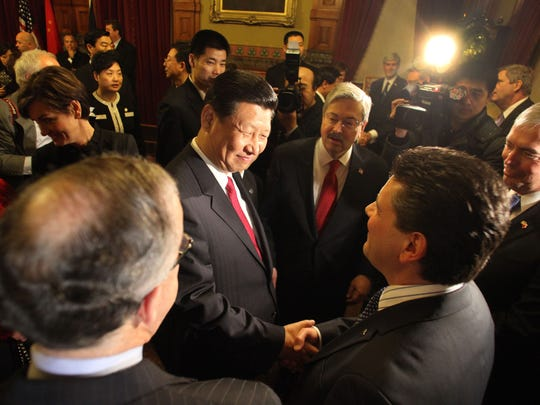 """Chinese Vice President Xi Jinping in February 2012 at the Iowa State Capitol reunites with """"old friend"""" Luca Berrone, general manager of SACMI USA GROUP in Des Moines. Berrone provided Xi with his introduction to Iowa and America in 1985."""