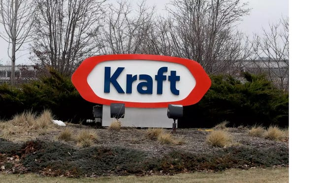 he Kraft logo appears outside of the headquarters on Wednesday, March 25, 2015, in Northfield, Ill. Some of the most familiar names in ketchup, pickles, cheese and hot dogs are set to come under the same roof after H.J. Heinz Co. announced plans to buy Kraft and create one of the world's largest food and beverage companies.