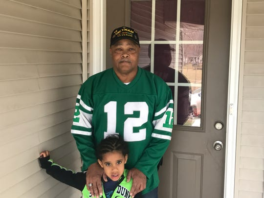 Mike Chambers and his grandson, Jysean, stand outside