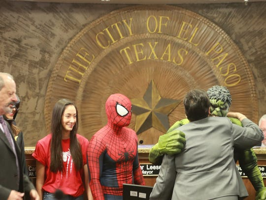 The Hulk hugs city Rep. Lily Limon during Tuesday's City Council meeting. Superhero volunteers who visit hospitalized children were honored with a proclamation by council.