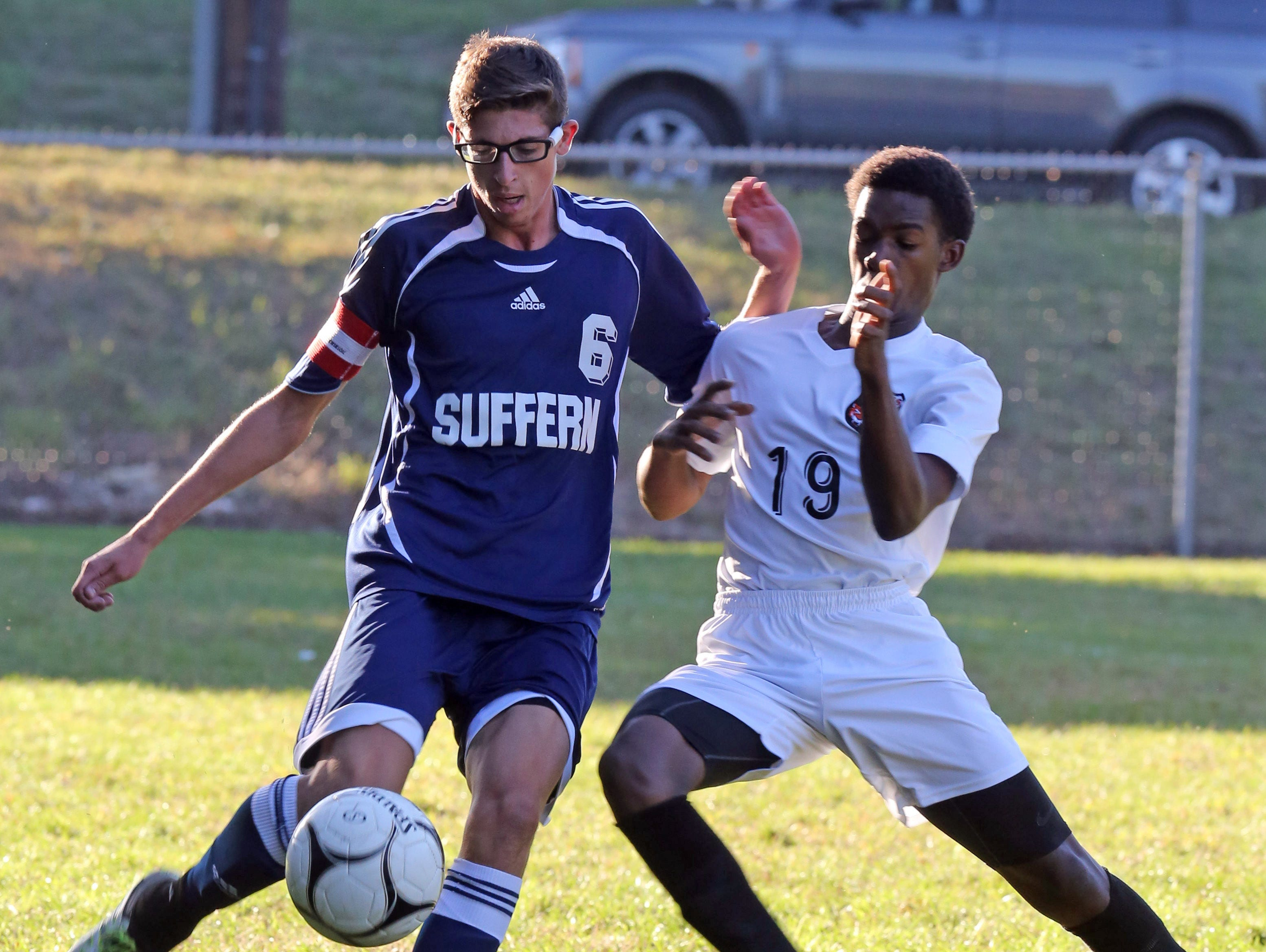 Suffern's Matt Iaria (6) and Spring Valley's Reedson Therneus (19) battles for control of the ball during boys soccer at Spring Valley High School on Oct. 6, 2016.