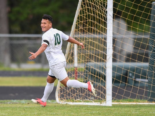 Berea's Wilbert Perez celebrates after scoring against Newberry during their AAA playoff match at Berea on Wednesday, May 3, 2017.