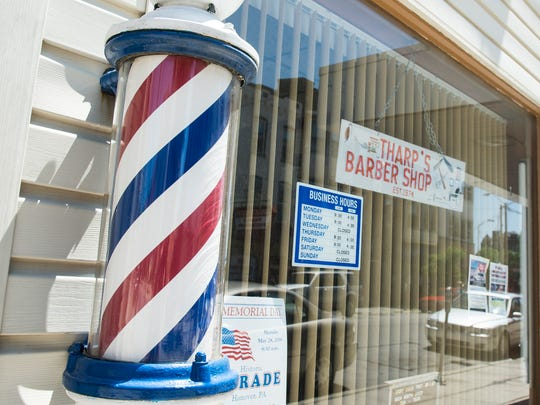 Richard Tharp has been cutting hair in the same location on Broadway since 1975.