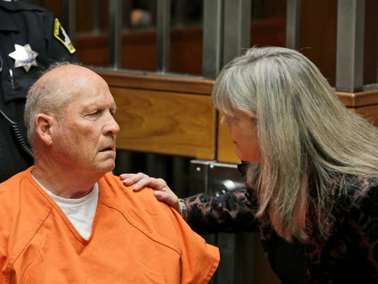Public defender Diane Howard, right, speaks with Joseph James DeAngelo, 72, who authorities suspect is the so-called Golden State Killer responsible for at least a dozen murders and 50 rapes in the 1970s and 80s, during his arraignment, Friday, April 27, 2018, in Sacramento County Superior Court in Sacramento, Calif.  (AP Photo/Rich Pedroncelli)