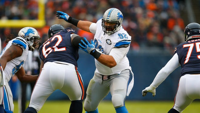 Detroit Lions defensive tackle Haloti Ngata (92) rushes the passes against the Chicago Bears during an NFL football game, Sunday, Jan. 3, 2016, in Chicago. The Lions won the game 24-20.