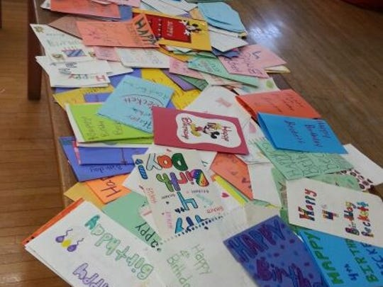 Piles of cards made by South Park students are ready to be sent to Beckett Roerdink.