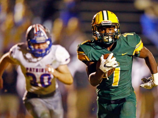 Gallatin's Ladarius Stewart (1) runs for yardage during their game against Page, Friday, Nov. 3, 2017, in Gallatin, Tenn. (Photo by Wade Payne, Special to the Tennessean)