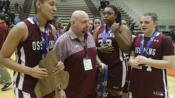 Ossining coach Dan Ricci walks off the court with his players after their loss to Baldwin in the girls Class AA state championship game at Hudson Valley Community College in Troy March 18, 2017.