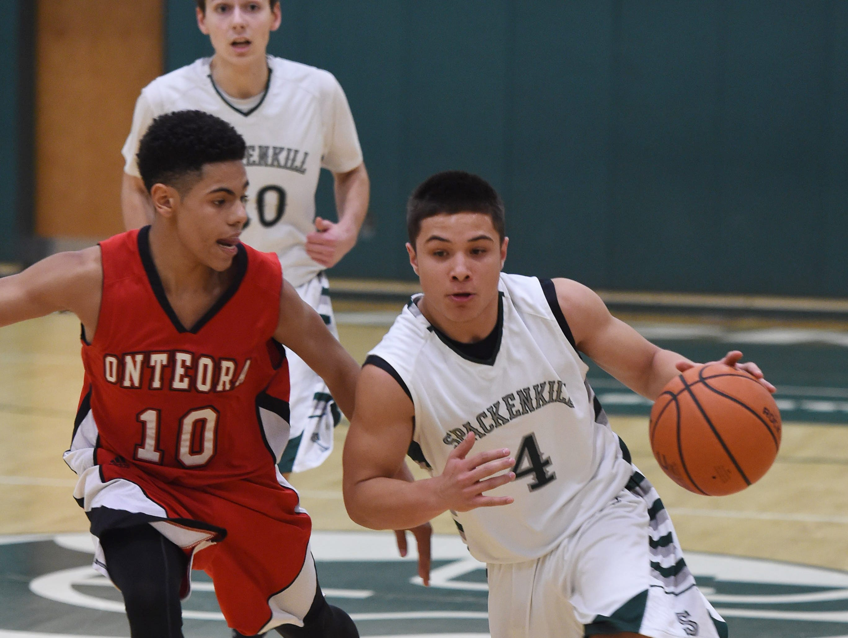 Spackenkill's Camron Abalos drives to the net past Onteora's, Jameson Morton during Thursday's game at Spackenkill.