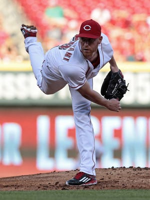 Cincinnati Reds starting pitcher Anthony DeSclafani (28) follows through on a pitch in the top of the second inning of the MLB interleague game between the Cincinnati Reds and the Oakland Athletics at Great American Ball Park in downtown Cincinnati on Friday, June 10, 2016.