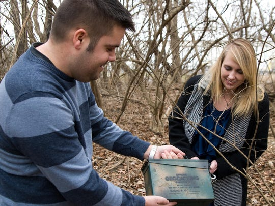 Jon and Susan Ziulkowski find the cache they were hunting.