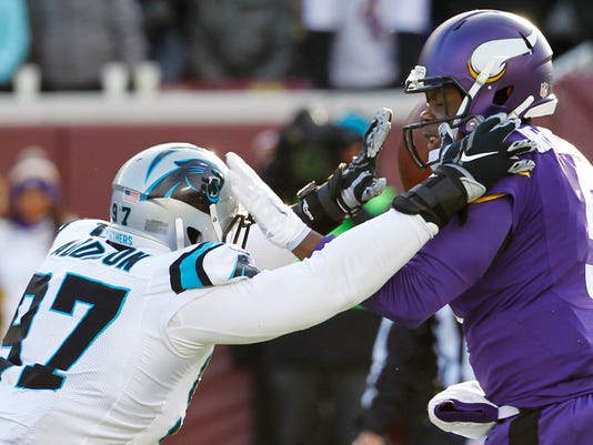 Minnesota Vikings quarterback Teddy Bridgewater, right, is pressured by Carolina Panthers defensive end Mario Addison during the second half of an NFL football game, Sunday, Nov. 30, 2014, in Minneapolis. (AP Photo/Ann Heisenfelt)
