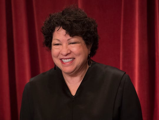 Associate Justice Sonia Sotomayor poses for a group