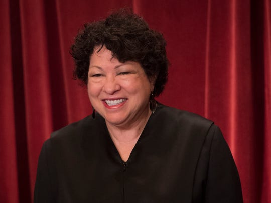 Associate Justice Sonia Sotomayor poses for a group photo with all nine Supreme Court Justices June 1, 2017 in the East Conference Room of the Supreme Court Building.