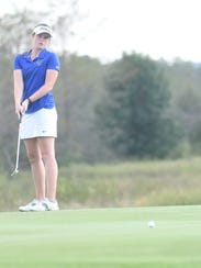 Mountain Home's Kenzie Collins watches a putt during