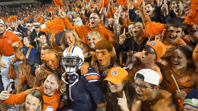 Auburn wide receiver D'haquille Williams celebrates with fans after Auburn defeated LSU 41-7 on Oct. 4 at Jordan-Hare Stadium in Auburn.