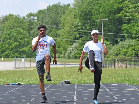 Brother and sister state track meet qualifiers Angelo Grose and Alaya Grose warm up at Mehock Field during practice Tuesday.