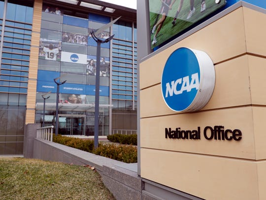 FILE - This March 12, 2020, file photo, shows the national office of the NCAA in Indianapolis. The NCAA will distribute $225 million to its Division I members in June, $375 million less than had been budgeted this year because the coronavirus outbreak forced the cancellation of the men's basketball tournament.  (AP Photo/Michael Conroy, File)