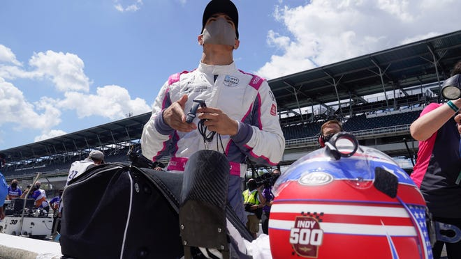 Alex Palou, of Spain, looks at his qualification results for the Indianapolis 500 auto race at Indianapolis Motor Speedway, Sunday, Aug. 16, 2020, in Indianapolis.