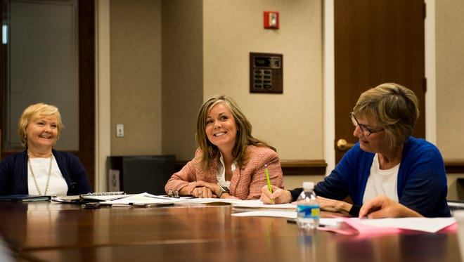 From left, Debbie Frasier, Katie Gambill and Lynn Stokes smile during the first organizational meeting for consolidated government this summer.