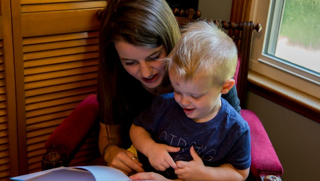 Samantha Miravalle reads to her son Finnegan Miravalle, 2, in their home. Miravalle is an advisory board member for the Imagination Library program of Montgomery County. The program recentlly won the reader's choice award for Favorite Local Social Service Agency.