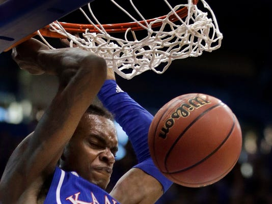 Kansas guard Lagerald Vick dunks during the first half of an NCAA college basketball game against West Virginia in Lawrence, Kan., Saturday, Feb. 17, 2018. (AP Photo/Orlin Wagner)