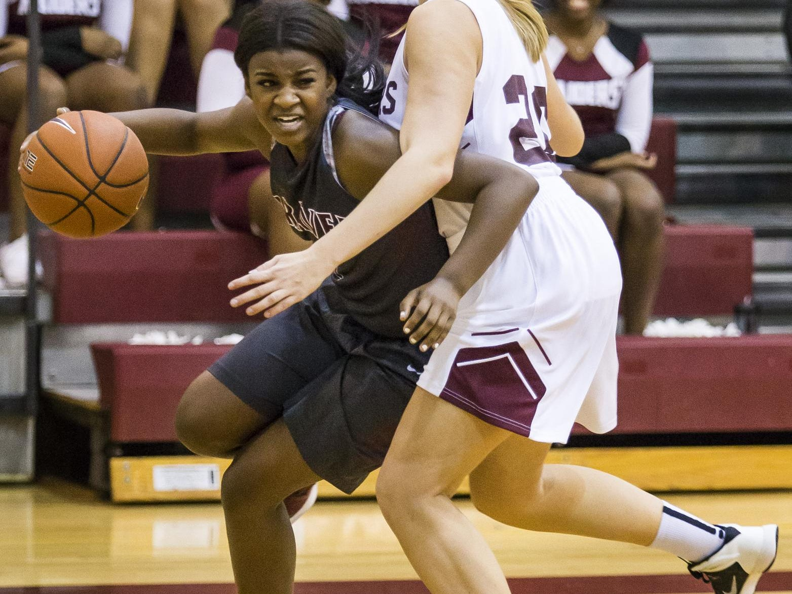 Caravel's Maia Bryson (left) tries to drive past a Concord defender in the first half of Caravel's 42-26 win over Concord at Concord High School on Monday night.